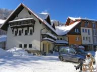 See the winter with Gronik guesthouse in the background
